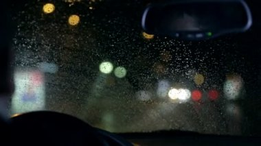 Unfocused nightdrive shot of wipers removing rain — Vídeo de Stock
