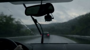 Shot through windscreen while driving on motorway on rainy evening — Stock Video