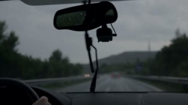 Windscreen wipers are removing rain while driving on motorway at evening — Stock Video