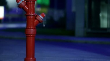 Man hitting the hydrant prop at night — Stock Video