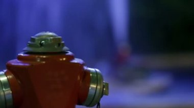 Pan shot from one hydrant to the other which is sprinkling the water in the air — Stock Video