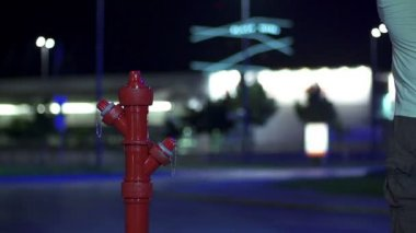 Man destroying the hydrant prop with a golf stick in slow motion — Stock Video