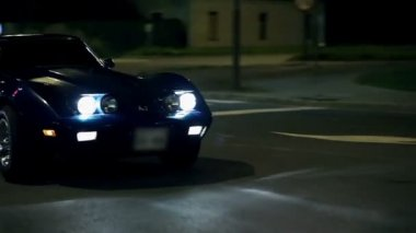 Corvette Stopping While Driving Around The City At Night — Stock Video