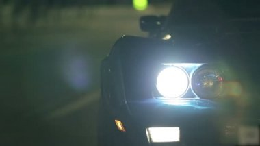 Corvette's Headlights As It Drives By — Stockvideo