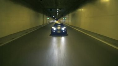Blue Corvette Driving At Night In A Tunnel — Stock Video