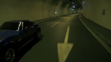 Blue Corvette Driving Through Tunnel — Stock Video