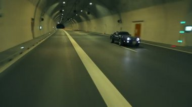 Blue Corvette Driving Fast Through The Tunnel — Stock Video