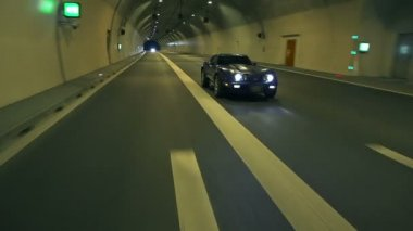 Corvette Drives Behind The Camera In The Tunnel — Stock Video