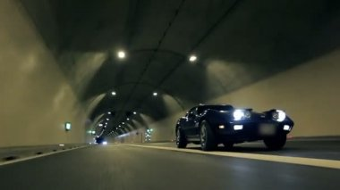 Blue car crosses the road in a tunnel — ストックビデオ
