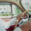 Bearded farmer with a hat is driving american vintage car — Stock Video #39326709