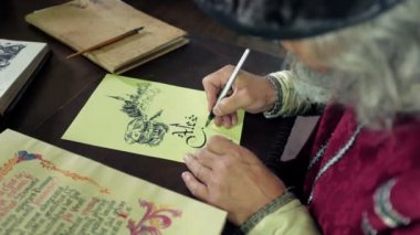 An old medieval scholar subscribing himself in calligraphic writing — Stock Video