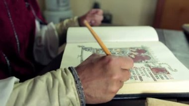 Medieval scholar who writes in calligraphic writing — Stock Video