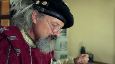 Medieval scholar at work — Stockvideo