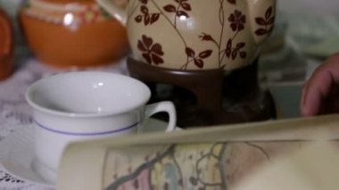 Shot of tea cups and a jar on the table — Stock Video