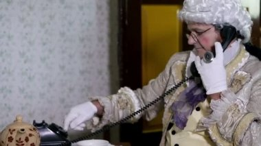 Man from 19th century dialing a phone number — Stock video