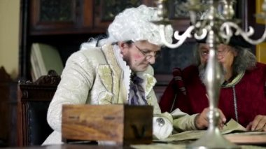 Scholar and noble man in old clothes during studying — Stock Video