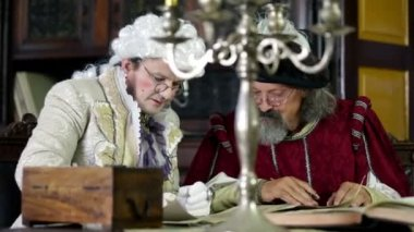 Scholar and noble man in old clothes during studying — Vidéo
