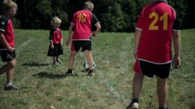 Football kids kicking a ball — Stock Video