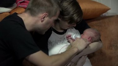 Parents fondle their newborn — Stock Video