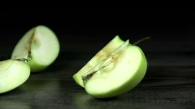 Pieces of green apple wobble around in slow motion — Stock Video