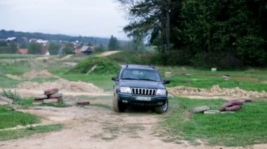 Jeep Turns Over On Driving Polygons — Stockvideo