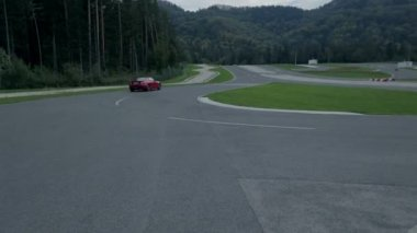 Car driving on a racing track fading in a distance — Stock Video