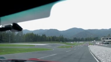 Driving hastly on a racing track shot from inside of a car — Stock Video