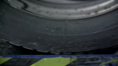 Detail of a rolling tire — Stock Video