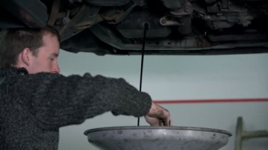 Mechanic takes something from a big funnel — Stock Video