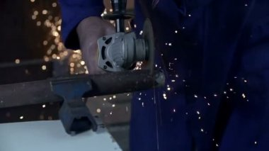 Sewing a metal rod in half with a lot of sparkling — Stockvideo