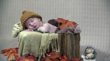 Baby boy resting in reminiscent of autumn scene — Stock Video