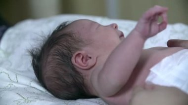 It takes about a baby moving its arms — Stockvideo