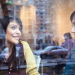 Stock Photo: Two girls talking in a cafe