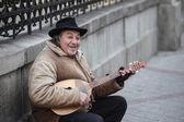 Senior street performer — Stock Photo