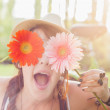 Young woman with flowers — Stock Photo #26370063