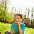 Stock Photo: Little boy using smart phone