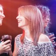 Group of beautiful young friends at the nightclub. - Stock Photo