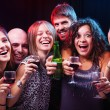 Group of beautiful young friends at the disco club. — Stock Photo