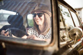 Young woman in old timer car. — Stock Photo