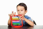 Smiling little boy counting — Stockfoto
