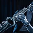 Young man playing the Saxophone. — Stock Photo