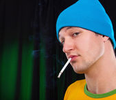 Young man with a cigarette — Stock Photo