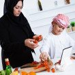 Arabic child in kitchen with mother — Stock Photo #50465293