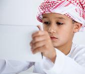 Arabic boy playing on tablet — Zdjęcie stockowe