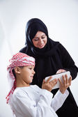 Arabic woman and son using tablet — Stock Photo