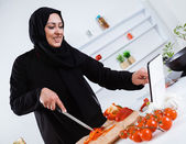 Arabian woman cooking in kitchen — Stock Photo