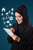 Middle Eastern Woman Using Digital Tablet — Stock Photo