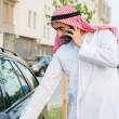 Arabian man Getting In Car — Stock Photo #50476063