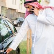 Arabian man Getting In Car — Stock Photo #50476115