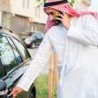 Arabian man Getting In Car — Stock Photo